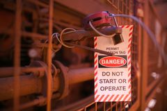 Danger tag permit operation do not start or operate the this equipment stock photo