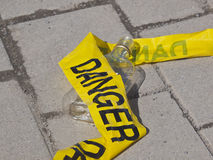 Danger Tape and Alcohol Bottle Stock Photos
