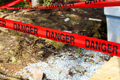 Danger tape cordoning off a concrete foundation Stock Images
