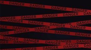 Danger tape in dark background Royalty Free Stock Photo