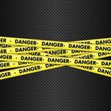 Danger tape on metallic background Stock Photo