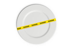 Danger Tape on Plate Stock Photography