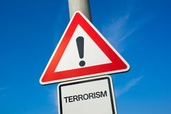 Danger of Terrorism. Terrorism - exclamation mark to alert, warn caution - danger and threat of terror and terrorist attack and assault made by radicals and Stock Image