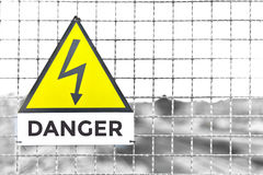 Danger Text Triangle Yellow Metal sign train deposit in. Italy  text white plate Stock Photos