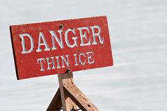 Danger thin ice. Warning sign by a lake Stock Photography