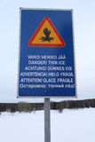 ` Danger!  Thin Ice` sign on different languages Royalty Free Stock Photography