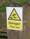 Danger Thin Ice warning sign royalty free stock photo