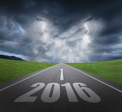Danger to new year concept. Danger to 2016 new year concept , rainstorm clouds and lightning with asphalt road Royalty Free Stock Photo
