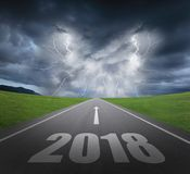 2018 new year concept. Danger to 2018 new year concept with rainstorm clouds and lightning Royalty Free Stock Photography
