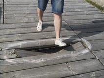 Danger to tread. Because of a broken board Stock Photos