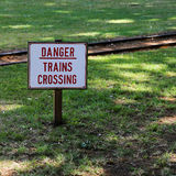Danger Trains Crossing Sign in the Zoo Stock Images