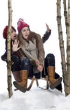 Danger: two young women on a sledge Stock Images