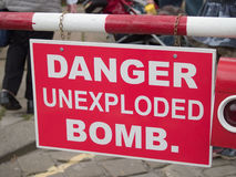 Danger unexploded bomb sign. At a wartime reenactment event in the UK Royalty Free Stock Image
