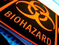 Danger Universal Biohazard Warning Label. Universal biohazard danger warning label on laboratory equipment in a science research lab Royalty Free Stock Images
