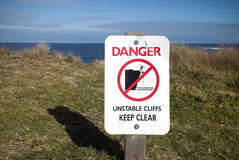 Danger unstable cliffs keep clear sign Royalty Free Stock Images
