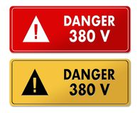 Danger 380V warning panels in French translation Royalty Free Stock Photo