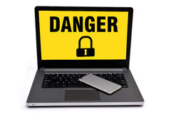 Danger vulnerable Sign lock with laptop and smart Stock Image