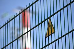 Danger warning sign. A warning sign in a fence of an electrical power plant Royalty Free Stock Images