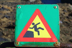 Danger. Warning sign on the Icelandic cliff Royalty Free Stock Images