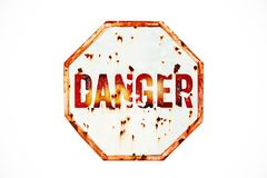 Danger warning sign over grungy white and red old rusty road traffic sign texture background royalty free stock photo