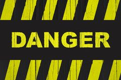Danger warning sign with yellow and black stripes Stock Image