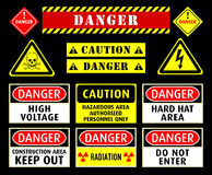 Danger warning symbols. Set of typical danger and caution warning symbols Royalty Free Stock Image
