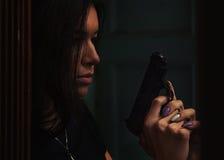 Danger woman with gun. Stock Image