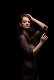 Danger woman with gun. Dark colors Royalty Free Stock Photo