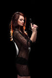 Danger woman with gun. Dark colors Stock Photos