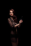 Danger woman with gun. Dark colors Stock Image