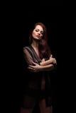 Danger woman with gun. Dark colors Stock Photography