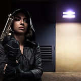 Danger woman with gun. On night street stock images
