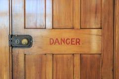 Danger wooden door Stock Photo