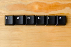 Danger word. With keyboard buttons Royalty Free Stock Photo