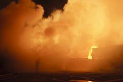 Danger work. Silhouette of firefighters - Danger work Stock Image
