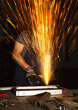 Danger at work. Danger work, labor use electric grinder in a wrong way Royalty Free Stock Photo