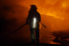 Danger work. Silhouette of firefighters Stock Images