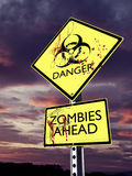 Danger Zombies ahead. Weathered bio hazard warning sign with blood royalty free stock photo