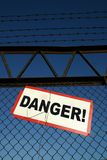 Danger zone!. Danger sign on the rusty fence Stock Image