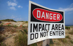 Danger Zone. Danger Impact Area Do Not Enter Sign on sand royalty free stock photo