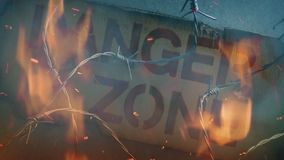 Danger Zone Sign With Fire And Smoke. Danger zone sign on wall with barbed wire and fire action concept stock video