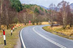 Dangerouns Bend in a Mountain Road Royalty Free Stock Images