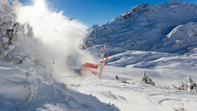 Dangerous accident of skier jumping in the air. Concept of risk and insurance Stock Photos