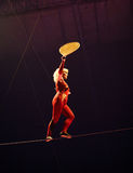 Walking on tightrope Royalty Free Stock Images