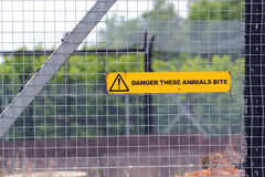 Dangerous animal sign on a fence Stock Photos