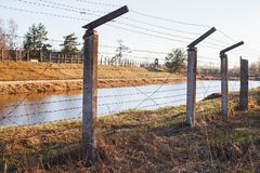 Dangerous area fenced with barbed wire fence stock photos