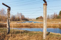 Dangerous area fenced with barbed wire fence royalty free stock photo