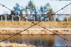 Dangerous area fenced with barbed wire fence stock image