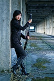 Dangerous asian girl. With katana in ruins Stock Photos