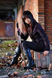 Dangerous asian girl. With katana in ruins stock images